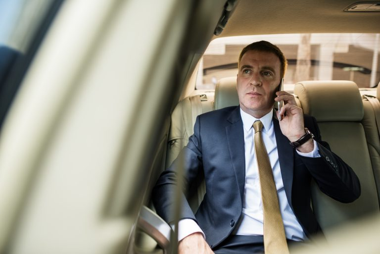 Businessman Talking Using Phone Car Inside